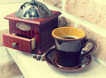 Cup of coffee, coffee grinder. still life Royalty Free Stock Photos