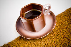 Cup of coffee on coffee grounds Royalty Free Stock Image