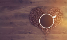 Cup of coffee on coffee heart, toned royalty free illustration