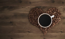 Cup of coffee on coffee heart Stock Photo