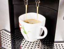 A cup of coffee and coffee machine Stock Photos