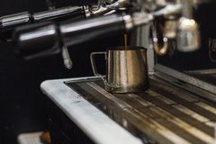 A cup of coffee in the coffee machine. royalty free stock photos