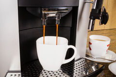Cup of coffee in a coffee machine Royalty Free Stock Photography