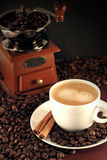 Cup of coffee and coffee mill Stock Photo