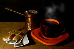 Cup of coffee,coffee pot and album with old photos Stock Photo