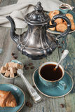 Cup of coffee, coffee pot and croissants Royalty Free Stock Photos
