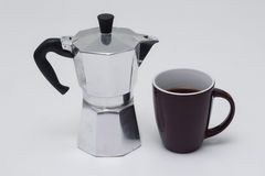 Cup of coffee with coffee pot Stock Photos