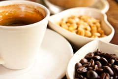 Cup of coffee and coffee seeds Stock Photos