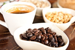 Cup of coffee and coffee seeds Stock Images