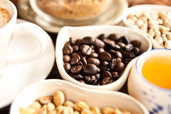Cup of coffee and coffee seeds Royalty Free Stock Images