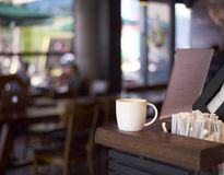 Cup of coffee on coffee shop counter Royalty Free Stock Photos