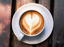 Cup of coffee in coffee shop, vintage color tone Royalty Free Stock Photos
