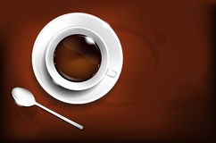 Cup of coffee and coffee spoon Royalty Free Stock Photo