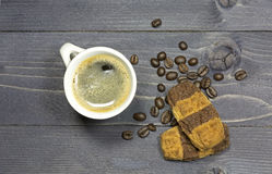 Cup of coffee and coffeebeans with double colored Royalty Free Stock Image