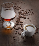 Cup of coffee, cognac glass and coffee beans Stock Images