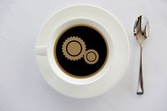 Cup of coffee with cogwheel symbol and spoon Royalty Free Stock Image
