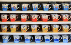 Cup coffee color. Color coffee cups on shelf Stock Images