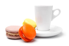 Cup of coffee  with colorful french macaroons Royalty Free Stock Photos