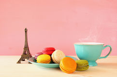 Cup of coffee and colorful macaron Stock Images