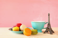 Cup of coffee and colorful macaron Stock Photos
