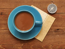 Cup of coffee and compass Stock Images