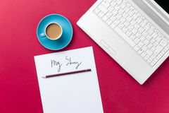 Cup of coffee and computer with paper and pencil Stock Images
