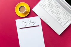 Cup of coffee and computer with paper and pencil Royalty Free Stock Image