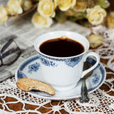 Cup of coffee and a cookie. stock images