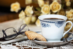 Cup of coffee and a cookie. stock photos