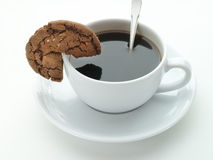 Cup of coffee and cookie Stock Photos