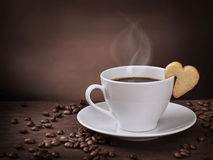 Cup of coffee with cookie Royalty Free Stock Image