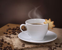 Cup of coffee with cookie Royalty Free Stock Images