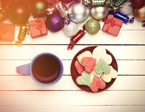 Cup of coffee and cookie with christmas toys on whte background. Royalty Free Stock Images