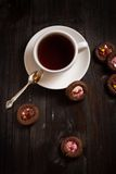 Cup of coffee and cookie on wood table Royalty Free Stock Images