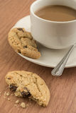 A cup of coffee and cookie Stock Images