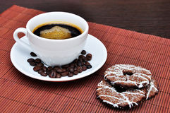 Cup of coffee with cookies. And coffee beans on the table Stock Images