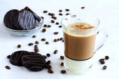 Cup of coffee and cookies. Cup of coffee with milk and chocolate cookies Royalty Free Stock Photography