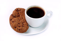 A cup of coffee and cookies. White cup of coffee and some cookies on white background Stock Photography