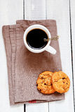 Cup with coffee and cookies Stock Photos