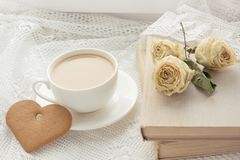 Cup of coffee with cookies as heart on lace. Vintage. Cup of coffee with cookies as heart and book with dry rose on lace. Vintage Stock Images