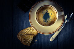 Cup of coffee cookies on a black background Stock Photos