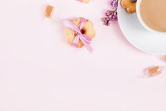 Cup of coffee with cookies, candies and lilac flowers Royalty Free Stock Photo