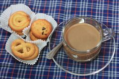 Cup of coffee and cookies on chintz Scots. Royalty Free Stock Photos