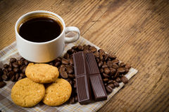 Cup of coffee with cookies. And chocolate bars on wooden background Royalty Free Stock Photography