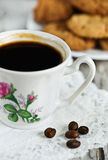 Cup of coffee, cookies and coffee beans Stock Photo