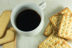 cup of coffee and cookies stock images