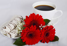 Cup of coffee, cookies and flowers Stock Image