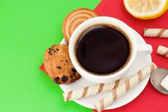 Cup of coffee and cookies on green Stock Photo