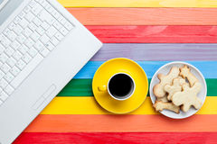 Cup of coffee with cookies and laptop Royalty Free Stock Photography
