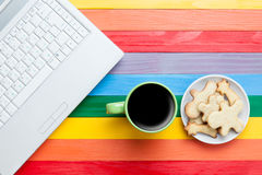 Cup of coffee with cookies and laptop Stock Photography